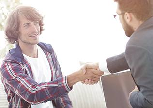 an HVAC specialist and a customer shaking hands